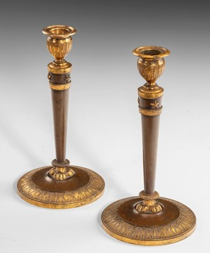 Pair of Empire bronze and ormolu candlesticks by Claude Galle