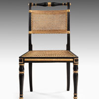 Regency dining chairs in ebonised and gilt decoration