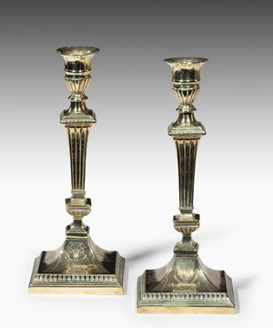 Pair of Irish Georgian engraved brass candlesticks