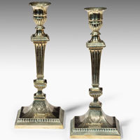Pair of Georgian Irish brass candlesticks