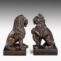 Antique pair of carved lions in walnut