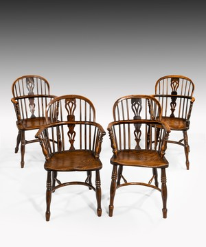 Set of four Nineteenth Century yewwod and elm Windsor armchairs