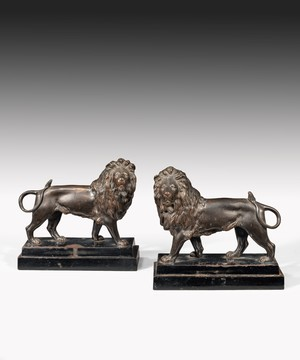 Pair of early Nineteenth Century Regency cast iron lion sculptures.