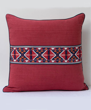 Antique red and indigo textile cushion