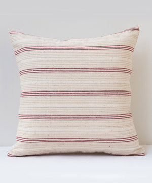 Small square striped cushion with antique textiles.