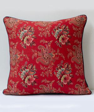 Square cushion covered in antique Russian fabric