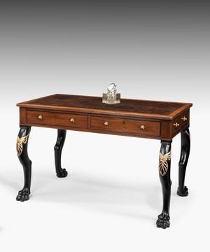 Regency mahogany writing table with carved monopodia legs