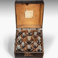 Antique Eighteenth Century decanter box with cut glass decanters