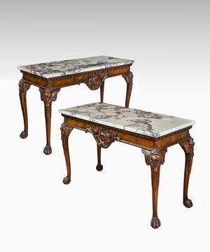 Pair of George II style carved mahogany console tables.