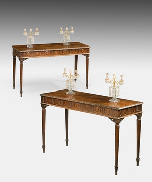 A pair of Italian carved consoles tables.