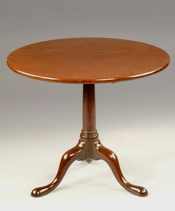 An antique Georgian mahogany tripod table.