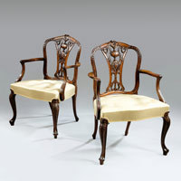 Antique pair of Sheraton revival armchairs.