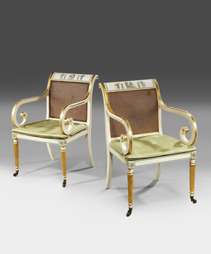 A pair of Regency style armchairs.