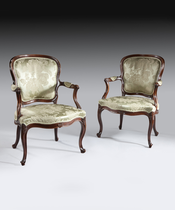 A pair of Hepplewhite salon armchairs.