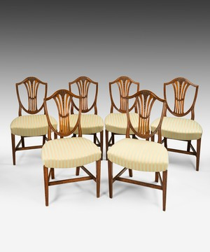 A set of 6 Sheraton dining chairs.