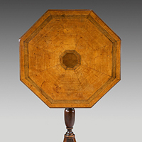An antique Georgian tripod table from the the Chippendale period.