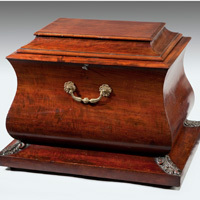 A good Regency period mahogany sarcophagus shaped wine cooler. Thumbnail 1