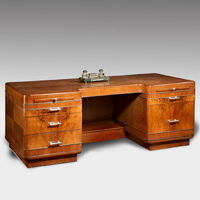 An art deco walnut desk.