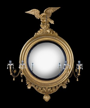 Regency convex mirror of large scale.