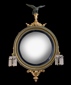 A Regency giltwood and bronzed convex mirror.
