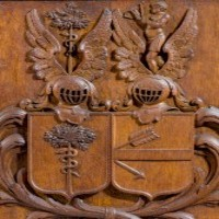 Carved gothic coat of arms.