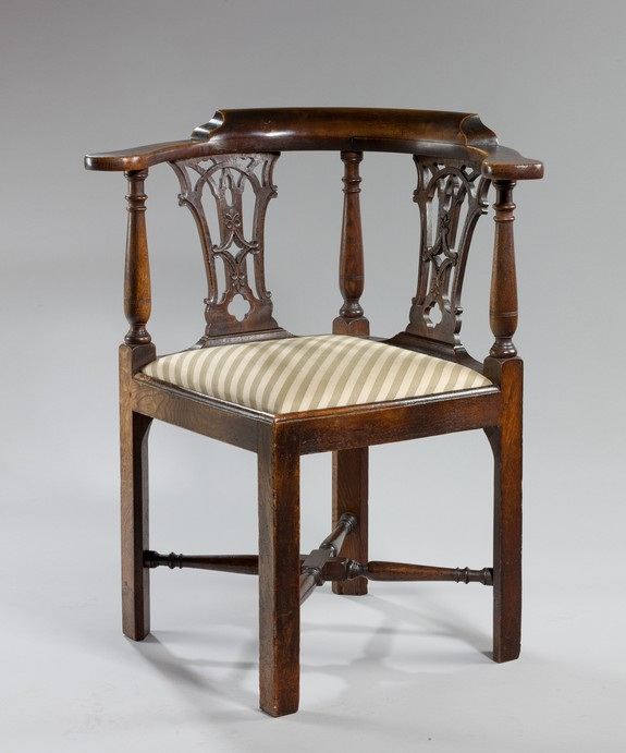 An antique Chippendale corner armchair