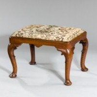 A George I walnut stool.