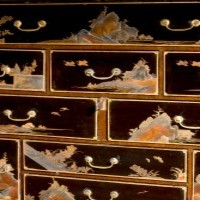 An antique Japanese lacquered cabinet.