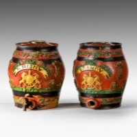 A pair of antique ceramic whisky and brandy barrels.