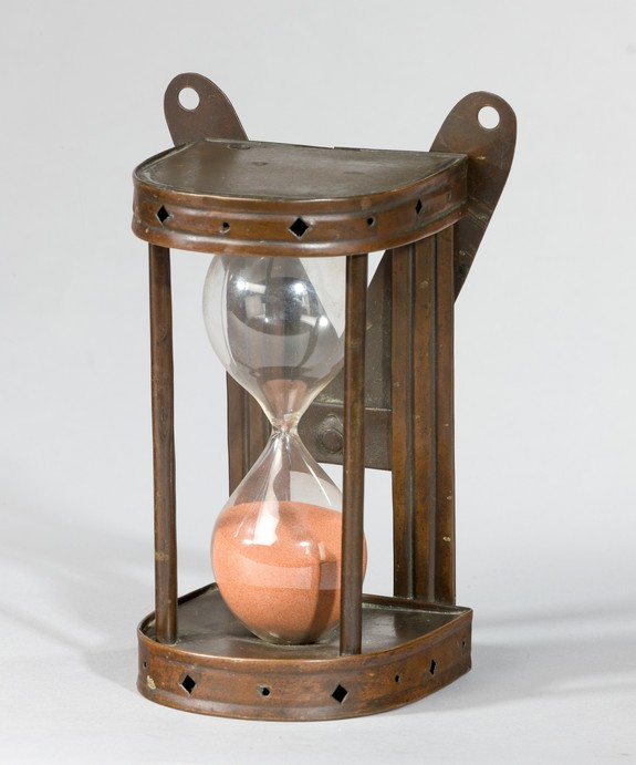 An antique copper egg timer.