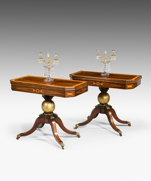 A pair of Regency period rosewood card tables.