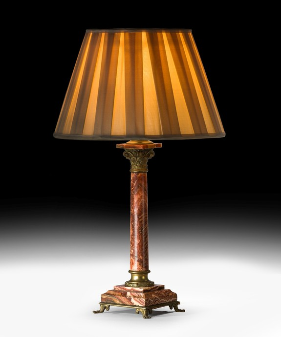 An antique table lamp in marble and ormolu.
