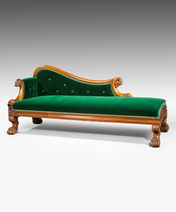 An antique Regency chaise longue.