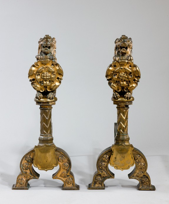 A pair of fire dogs in firegilded bronze inspired by Augustus Pugin.