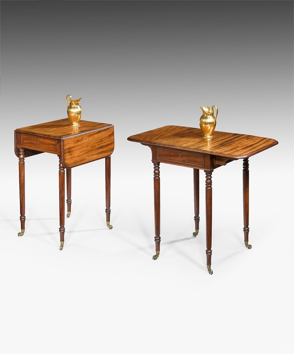 A pair of Regency mahogany pembroke tables.