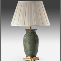 An antique Chinese celadon table lamp.