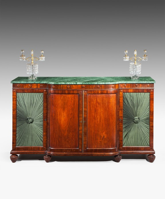 An antique Regency chiffonier with a bowfront.