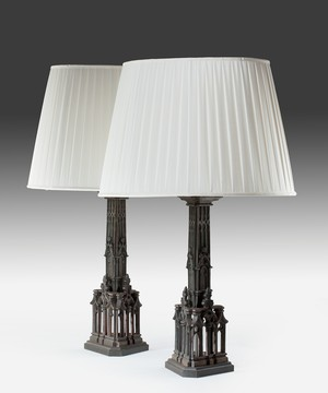 A pair of gothic bronze table lamps.