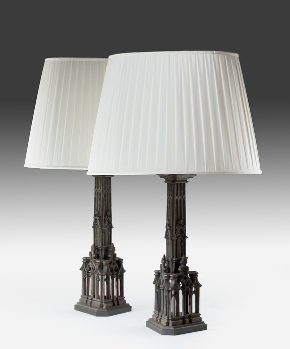 A pair of antique bronze table lamps.