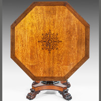 An antique Regency satinwood centre table.