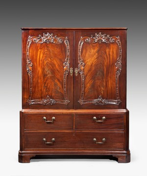 A carved Chippendale cabinet.