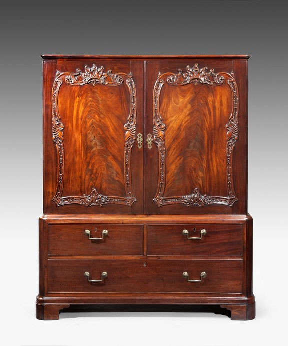 Georgian Chippendale cabinet with rococo carving.