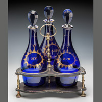 An antique Georgian decanter stand.