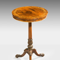 A carved rosewood antique tripod table.