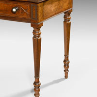 An antique Regency bowfront side table.