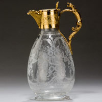 Antique engraved claret jug.