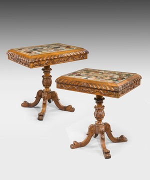 A pair of Regency marble topped tables.