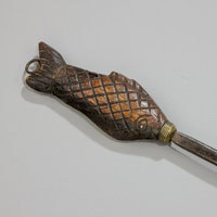 Antique toasting fork with fish handle.
