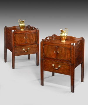 A pair of Chippendale bedside tables.