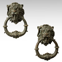 A pair of 19th Century bronze door knockers
